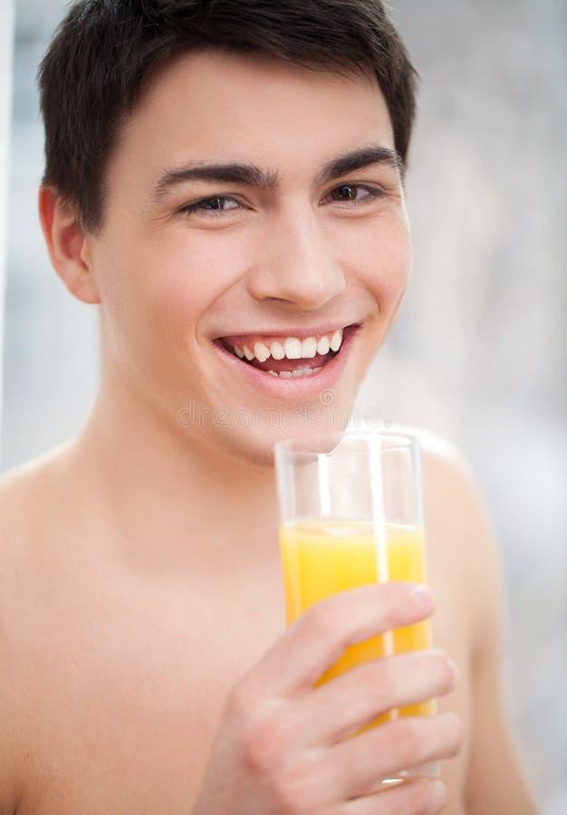 Shirtless Young Man Drinking Orange Juice Stock Photo ...
