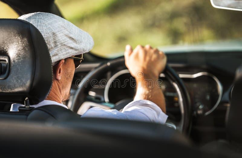 Men Driving Convertible Car stock image