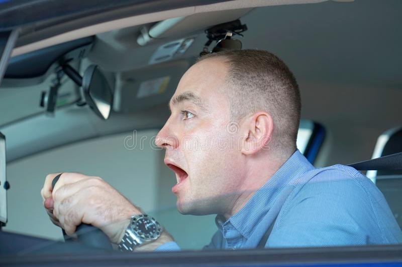 Men driving. emotion. Screaming, scared. Human emotion face expression. stock images