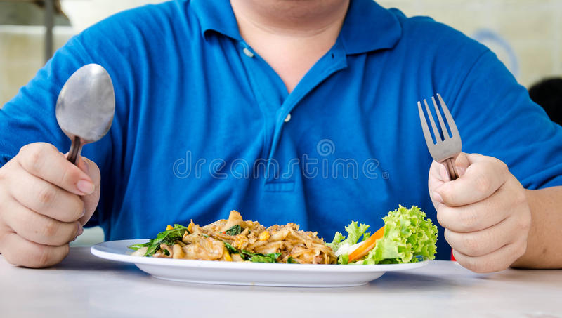 Men eating noodles close up royalty free stock photography