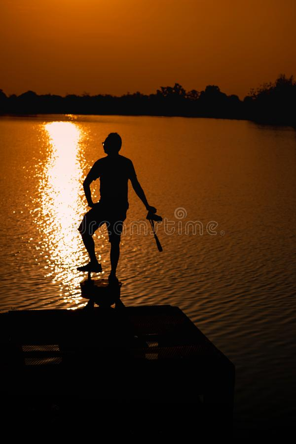 Men are at the edge of the reservoir and View Reservoir In the evening and Sunset stock images