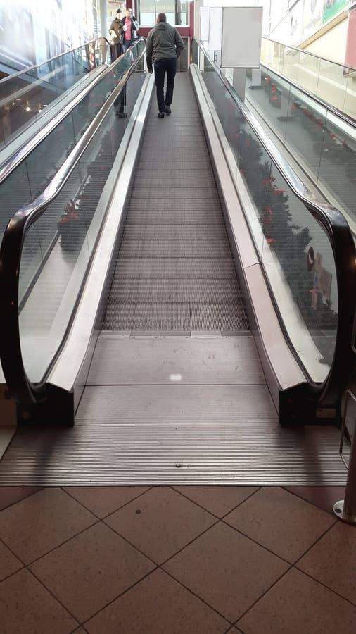 The men on the escalator royalty free stock photos