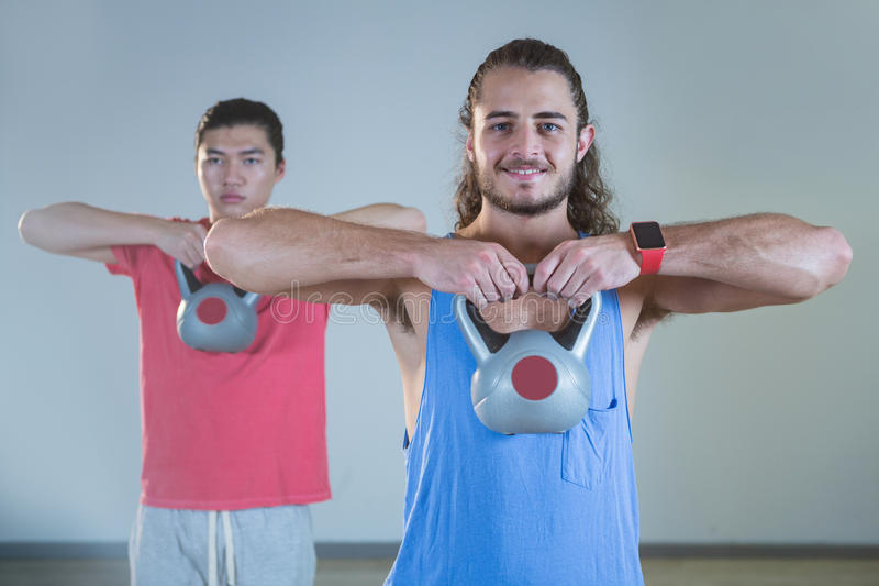 Men exercising with kettlebell royalty free stock image