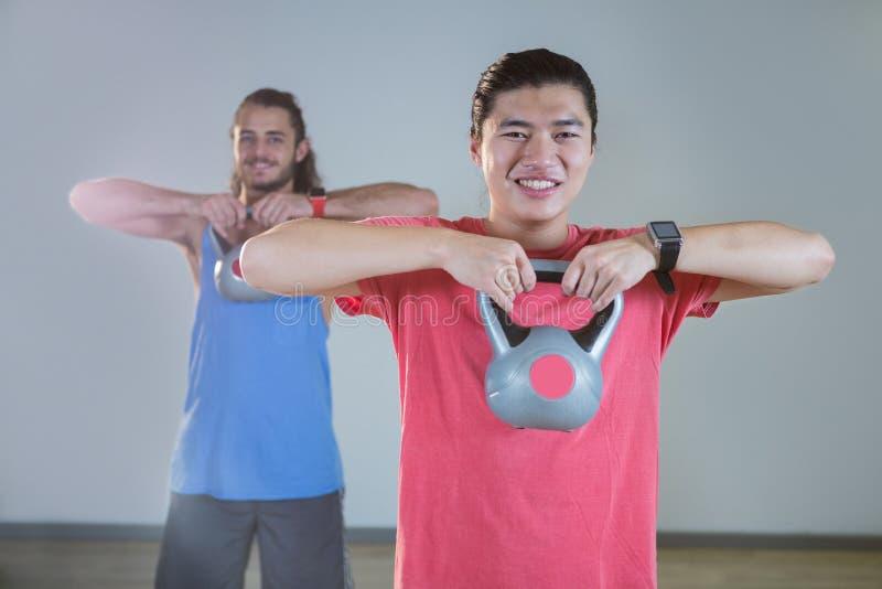 Men exercising with kettlebell royalty free stock photos