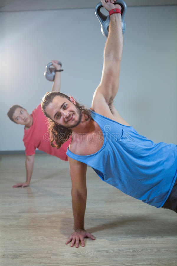 Men exercising with kettlebell royalty free stock images