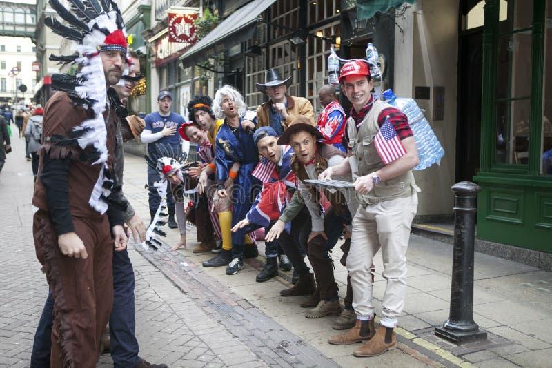 Men in fancy dress are having fun on the street near Embankment. LONDON, ENGLAND - December 17 , 2017 Men in fancy dress are having fun on the street near stock photography