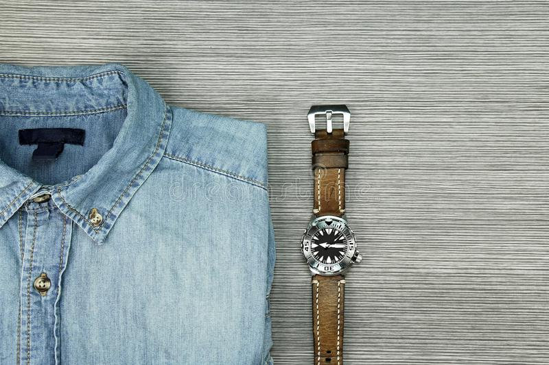 Men Fashion, Blue jeans shirt and men watch. Color Process royalty free stock photos