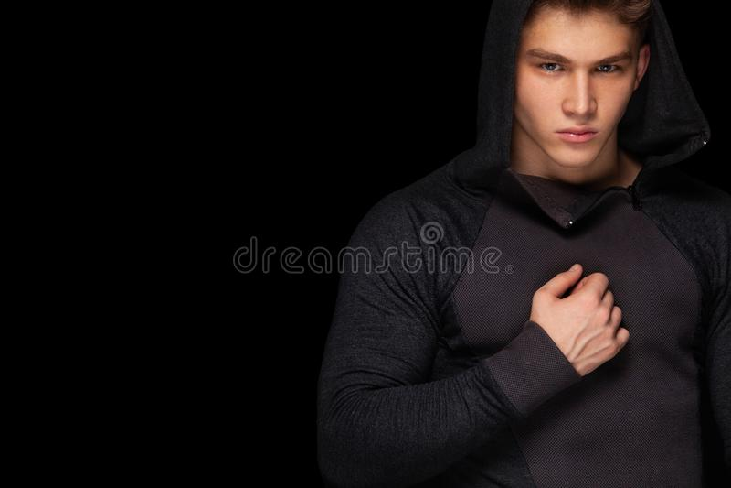Men fashion. Close-up portrait of a brutal and fit man. Athlete bodybuilder on black background. royalty free stock image