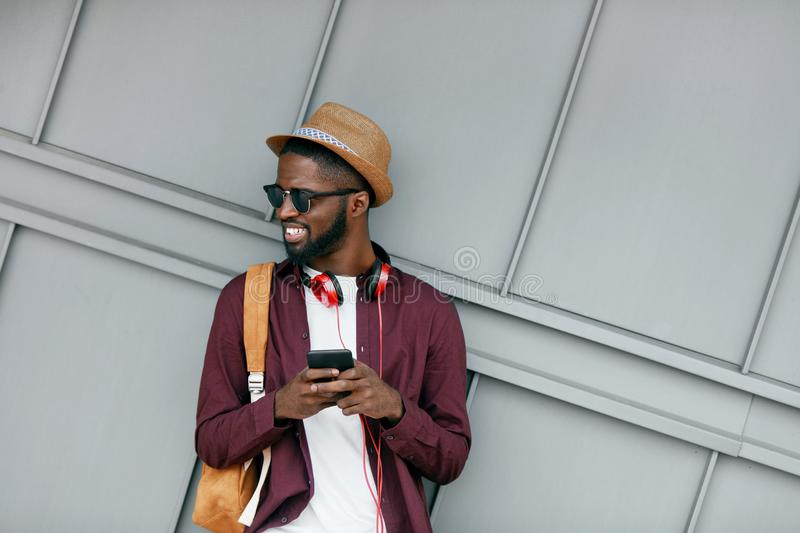 Men Fashion. Man With Phone And Headphones On Street royalty free stock photos