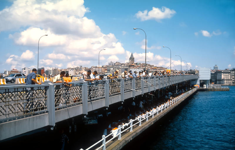 Men fishing from the Galata Bridge Istanbul Turkey royalty free stock photography