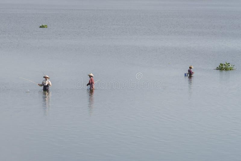 Men fishing in the lake royalty free stock photos