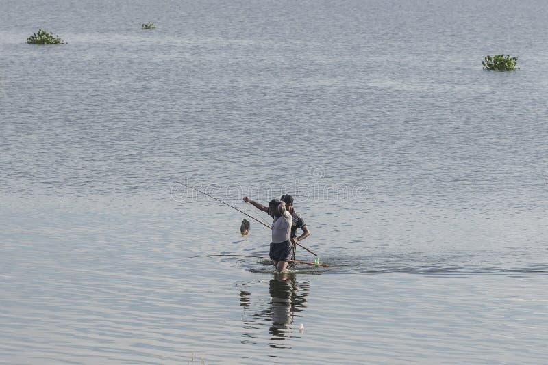 Men fishing in the lake royalty free stock images