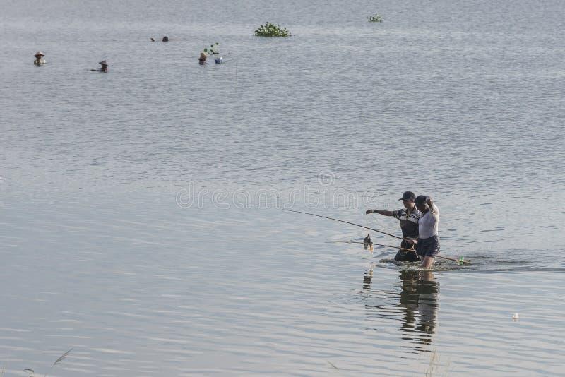 Men fishing in the lake stock image