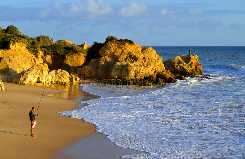 Men fishing from Sietskes Beach on the Algarve coast royalty free stock images