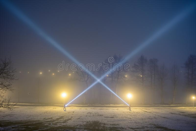 Men flashlights at night. royalty free stock photos