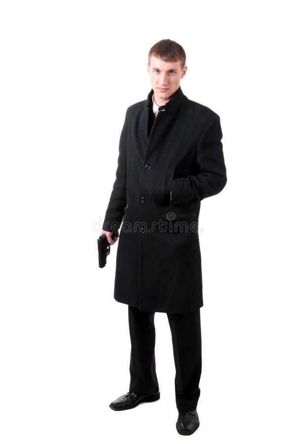 Men in formal wear with gun royalty free stock photo