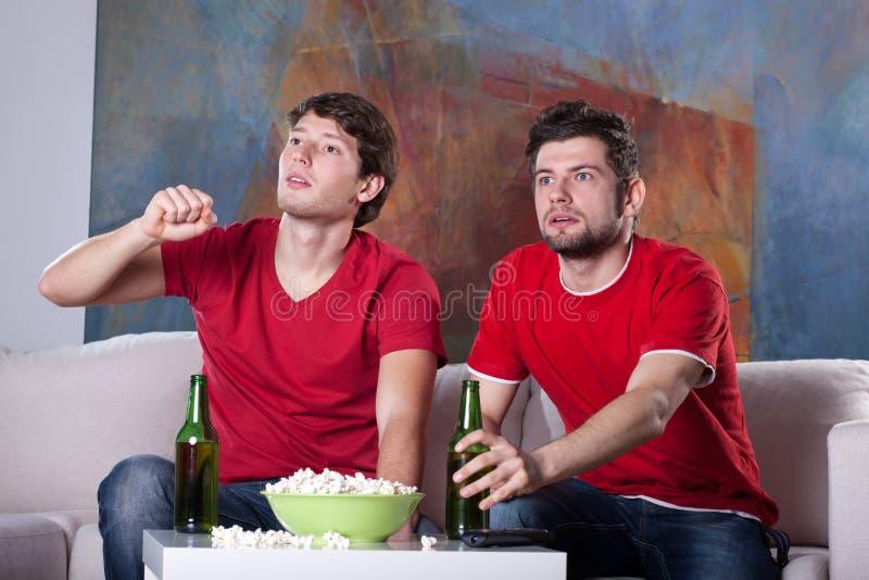 Men friends' home cinema stock photography
