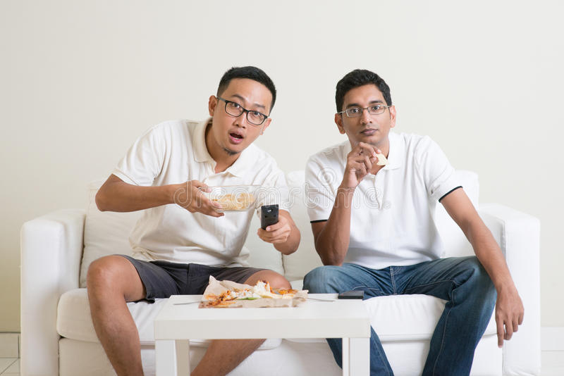 Men friends watching sport match on tv together stock photo
