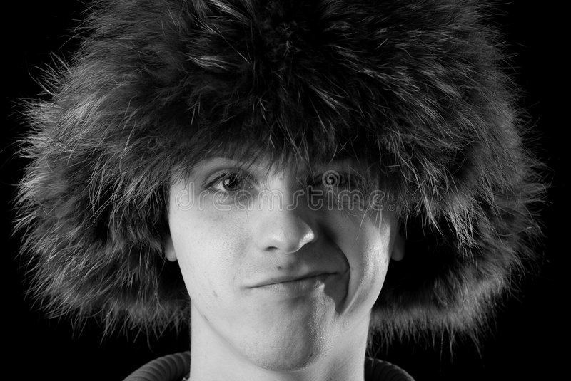 Men in fur cap. Portrait of a men in fur cap with ear flaps royalty free stock photo