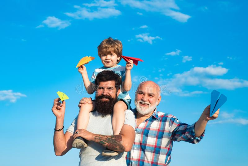 Men generation. Generation of people and stages of growing up. Father and son enjoying outdoor. Father and son with. Grandfather - happy loving family stock photos