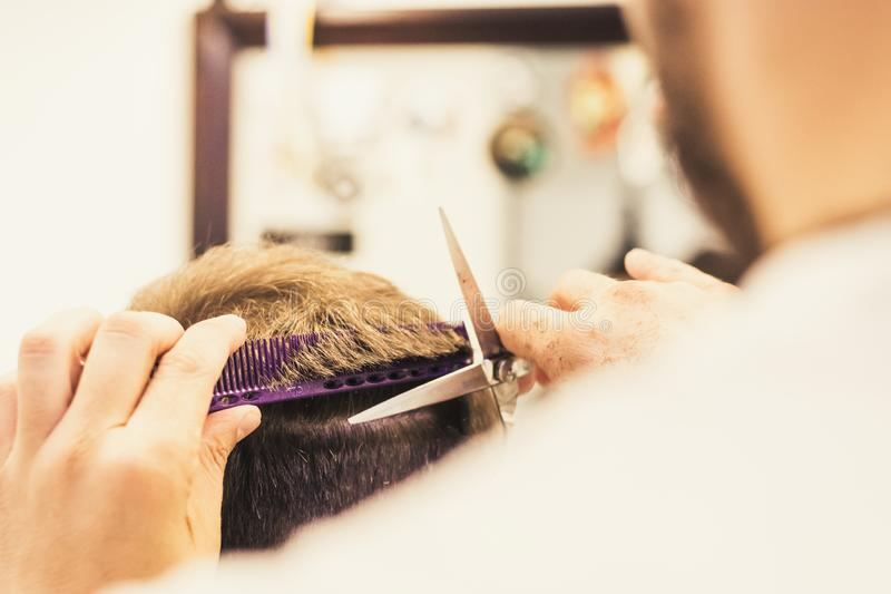 Men getting haircut from barber royalty free stock images