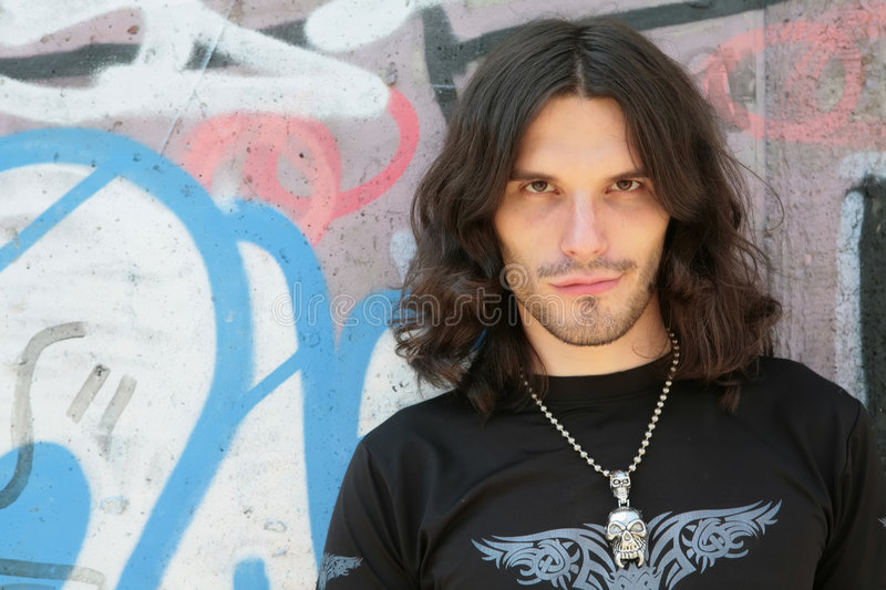 Men in gothic style. Closeup portrait of the long-haired young men in gothic style royalty free stock images