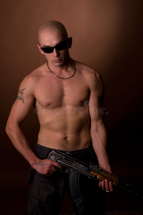 Download Men with gun stock image. Image of safety, bald, young - 6404071