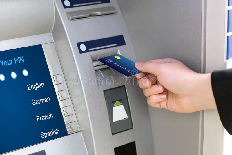 Men hand businessman puts credit card into ATM royalty free stock photography