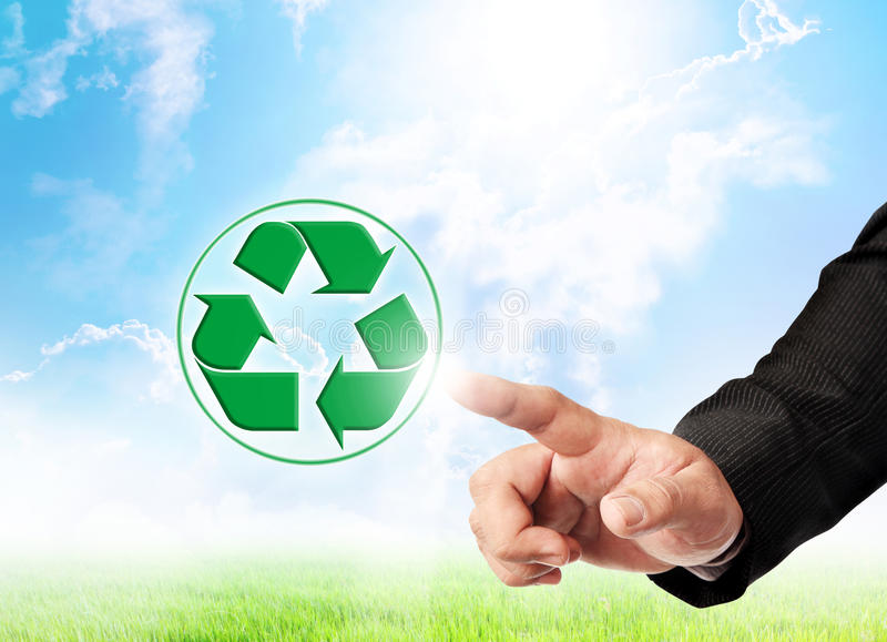 Men hand hold recycle sign. Male hand and recycle sign on nature background for green world concept stock photography