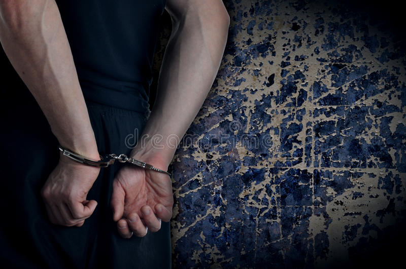 Men with handcuffs stock photos