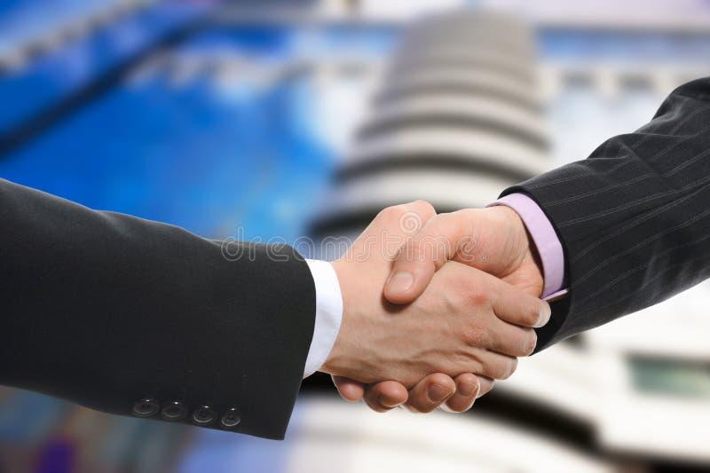 Men handshake stock images
