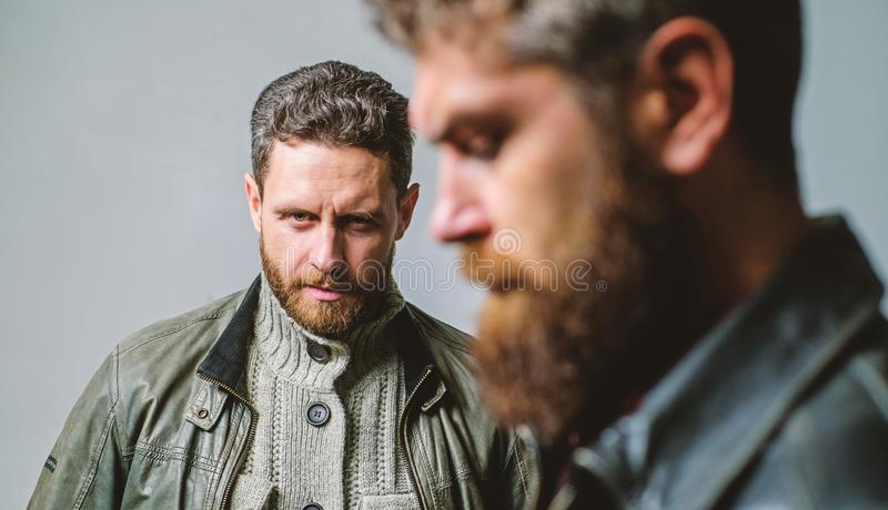 Men handsome with beard and mustache facial hair. Barber and beard grooming. Masculine men with well groomed beard. Masculinity and brutal appearance. Male royalty free stock images