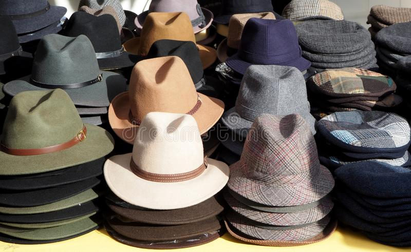 Men hats of different shapes and style display in a clothing store market.  royalty free stock image
