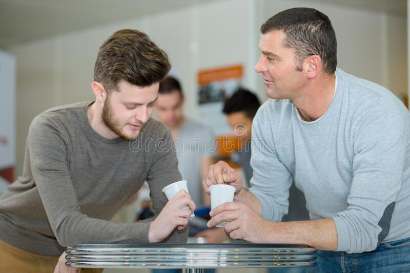 Men having coffee break stock photography