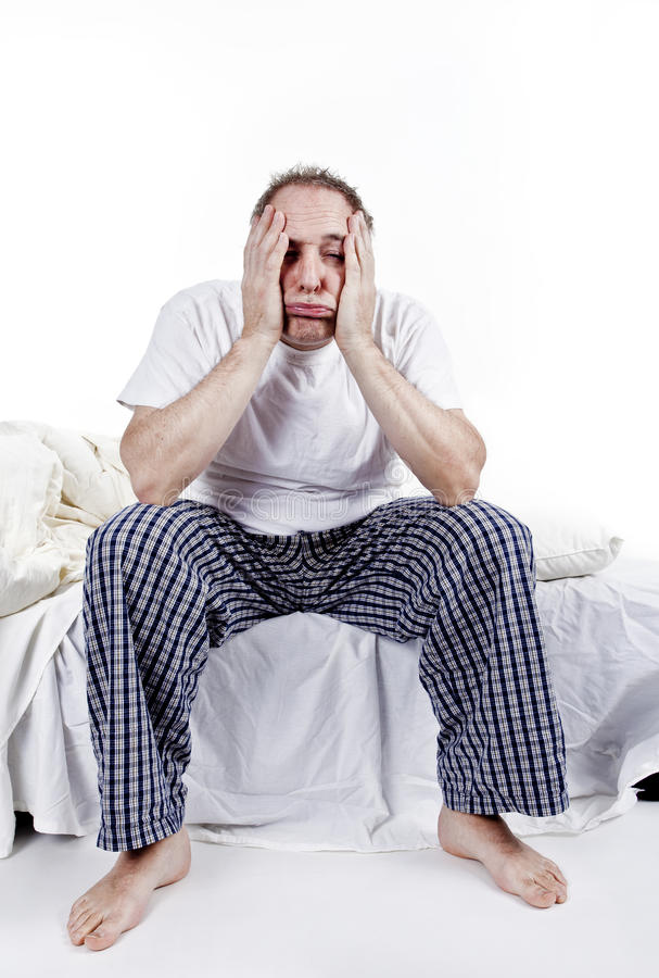 Men having a difficult morning. Forty years old men having a difficult time waking up stock image