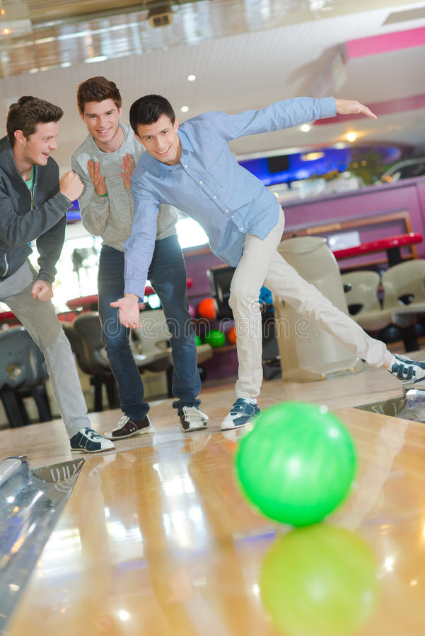 Men having fun in bowling center. Men having fun in the bowling center stock photography