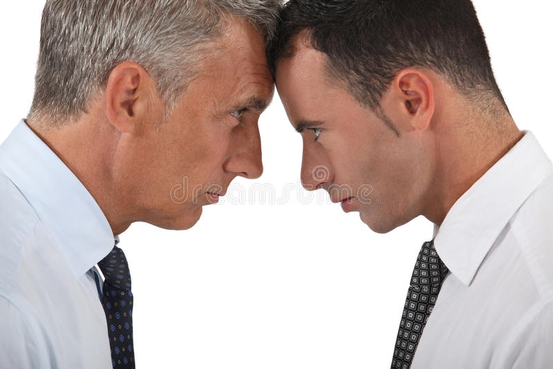 Men head butting royalty free stock images