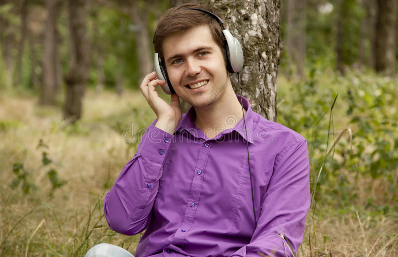 Men with headphones at the park