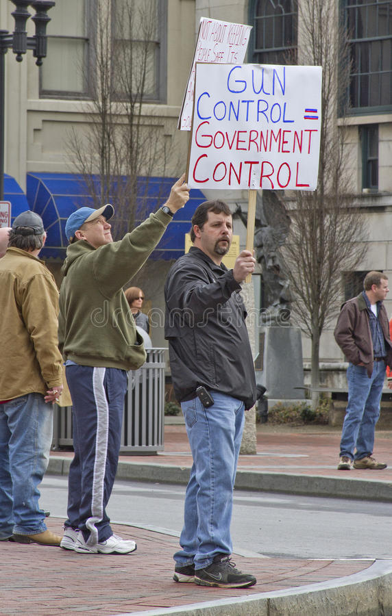 Men Holding Gun Control Protest Signs At Rally