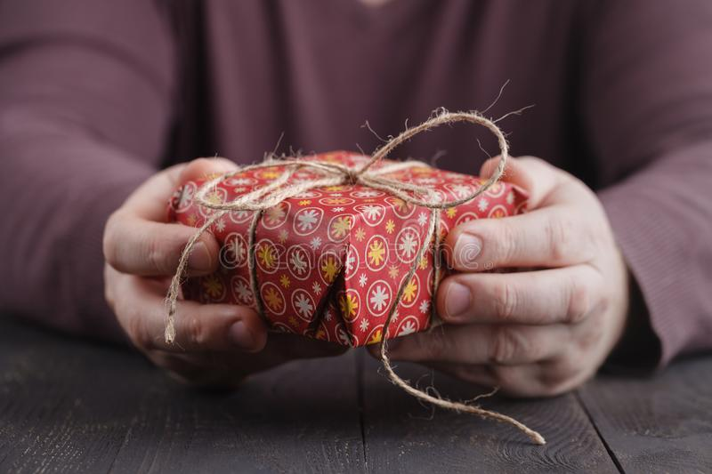Men holding handmade gift box in the hands. Christmas concept. New Years present stock images