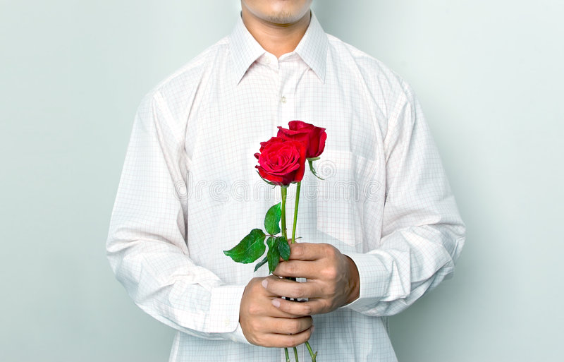 Men holding a roses royalty free stock photography