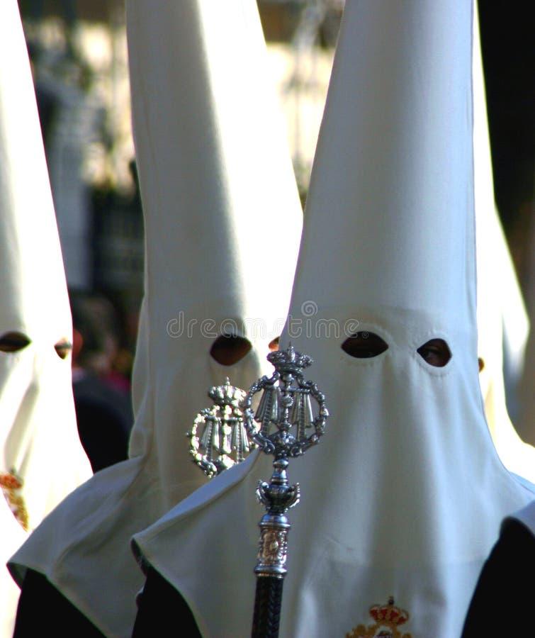 Men in hoods during Holy Week, Malaga, Spain stock images