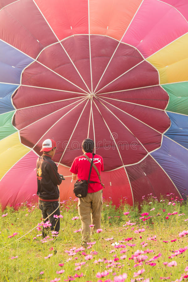 Men and hot air balloon on ground royalty free stock images