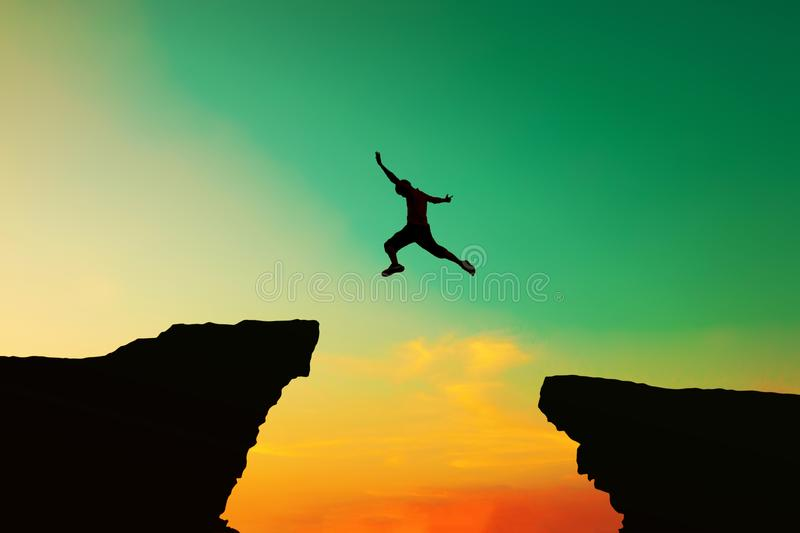 Men jumped from the old obstacles to new achievements, business, sucess, man. A man who is about to succeed And overcome obstacles stock photos