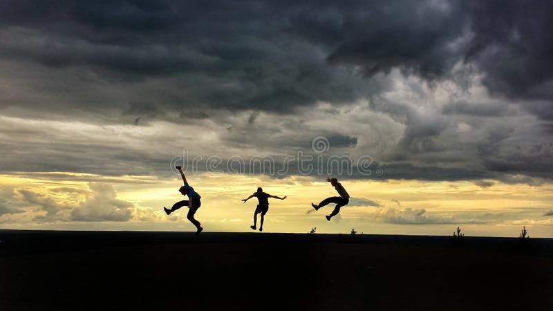 Men Jumping in Air royalty free stock photography