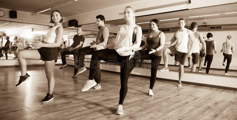 Men and ladies dancing zumba stock photo