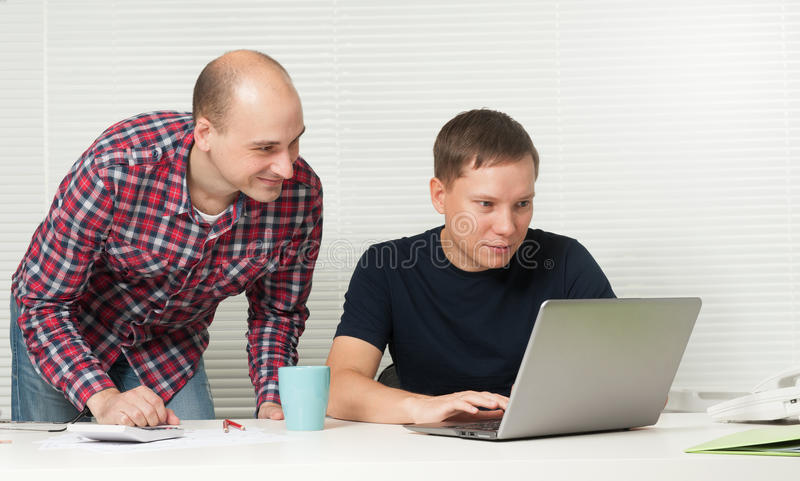 Men with laptop at office stock photos
