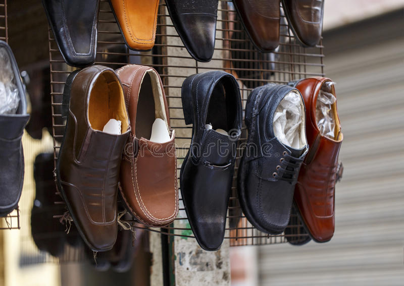 Men leather shoes in street market. royalty free stock photos