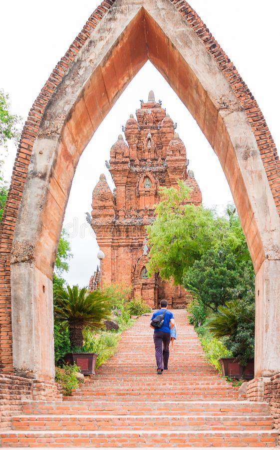 The man and little girl stand on the enter of Poklongarai champa tower. Located in Phan Rang, to the south of Nha Trang royalty free stock images