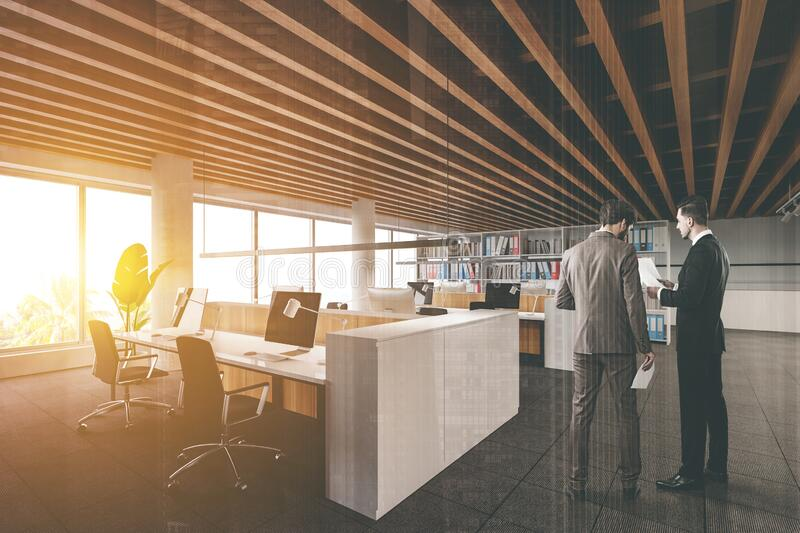 Men in loft open space office with meeting room royalty free stock photo
